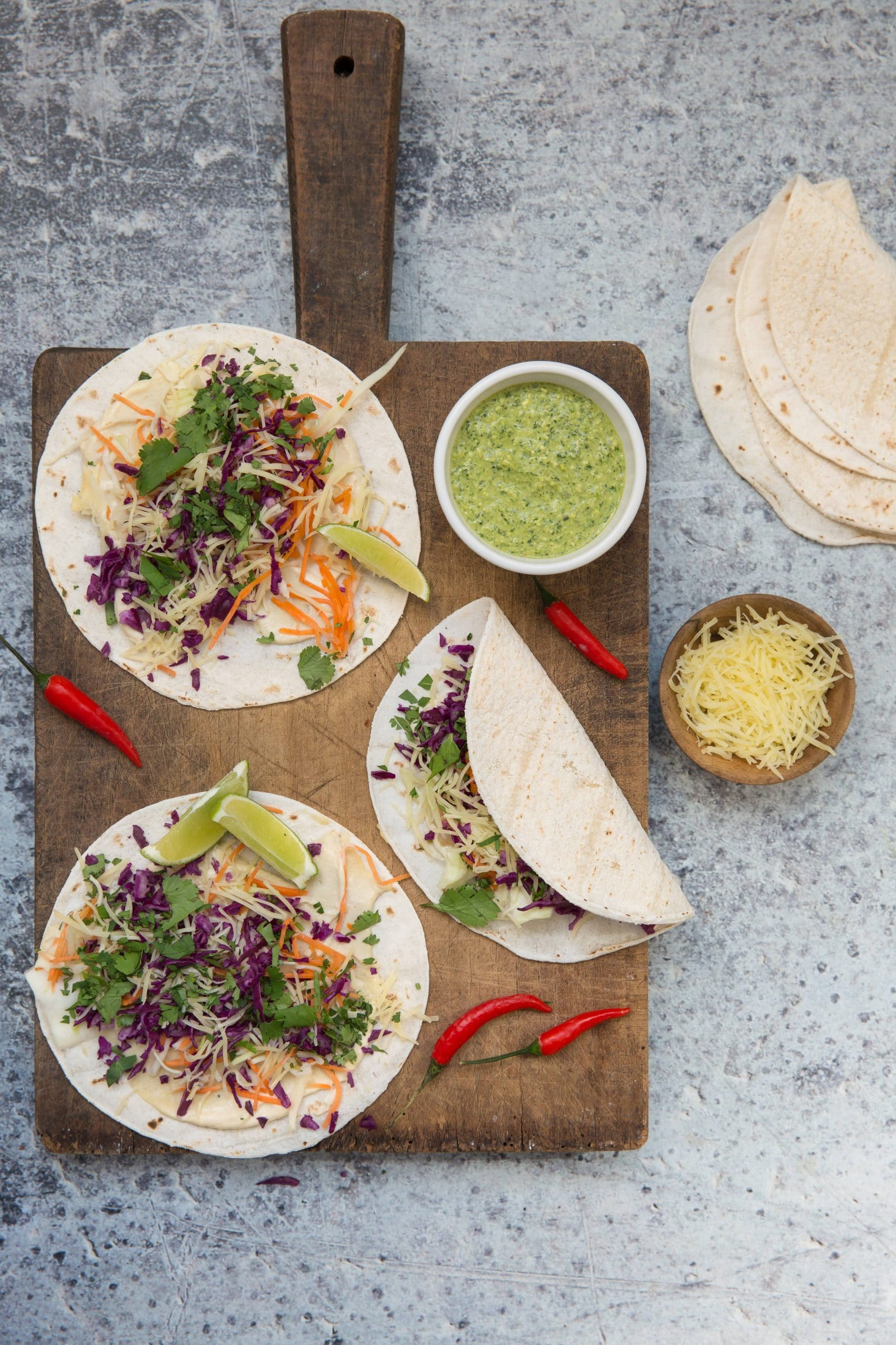 Vegetable and grated Entremont organic Emmental cheese tacos